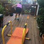 Working out on her back porch after work